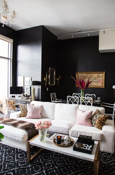 Black walls and white furniture