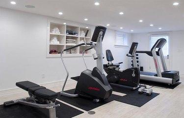 basement gym wit built-in storage