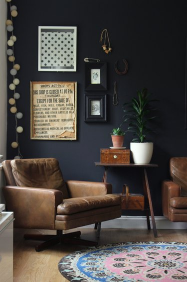 Black walls and leather furniture