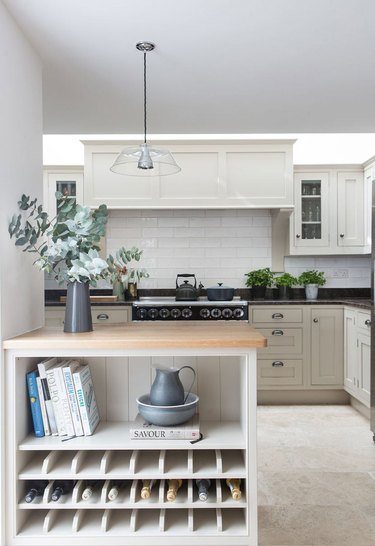 Kitchen island storage for wine with wood countertop