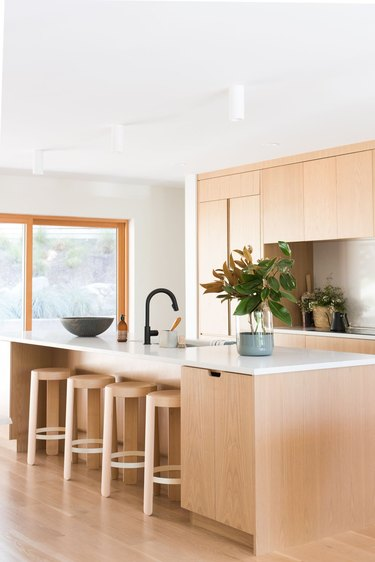 light wood kitchen cabinets with white countertops