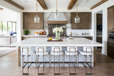 wood kitchen cabinets with white countertops and large island