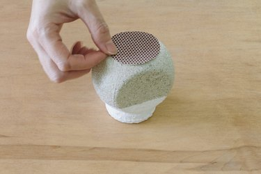 Adhering match striker paper to bottom of jar