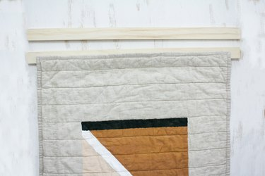 Placing quilt in between two 1x2 boards