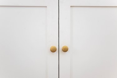 Knobs painted brass and attached to cabinet