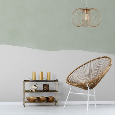 green-and-white wallpaper with chair and shelf