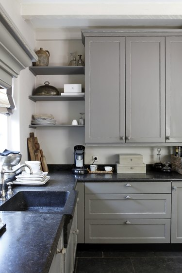 integrated sink in kitchen with quartz countertops and greige cabinets and open shelving