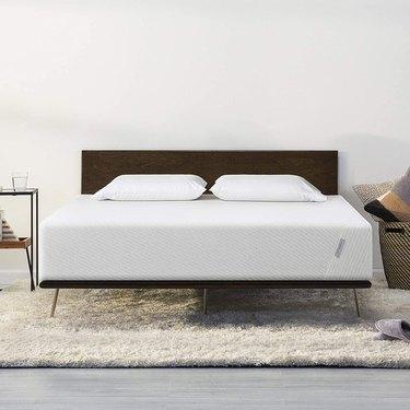 Mattress on wooden bedframe