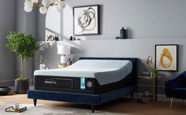 Mattress on blue bed frame