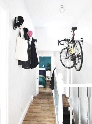 hanging bike rack in hallway with wall hooks