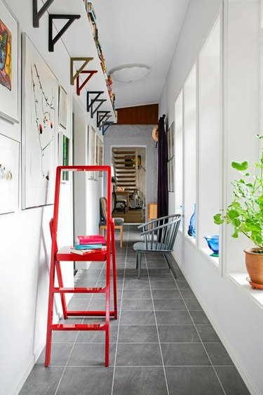 shelving in small hallway with red step ladder