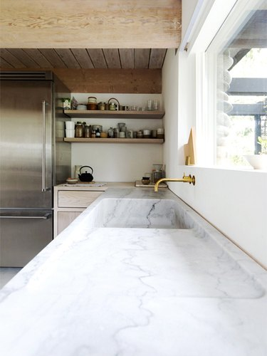rustic farmhouse kitchen with marble countertop and integrated sink