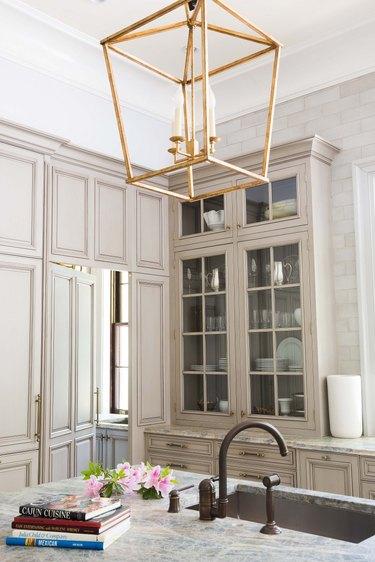 Italian Baroque kitchen cabinets in greige