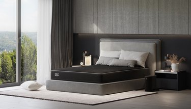 Black mattress on gray bed frame