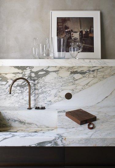 marble integrated sink and backsplash in kitchen