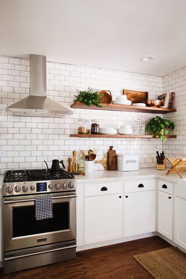 kitchen storage idea with white cabinets and white subway tile on wall