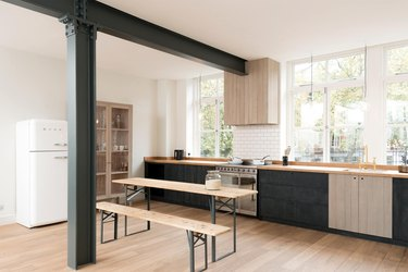 kitchen cabinet style with beadboard style wood cabinets in rustic industrial kitchen