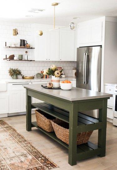 white kitchen with small olive green kitchen island