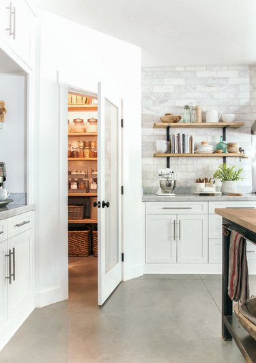 kitchen storage idea with organized pantry that has multiple storage solutions