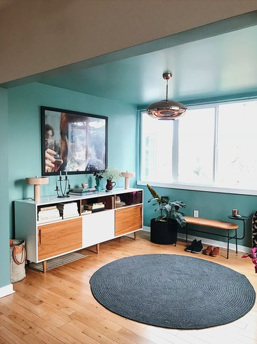 Designlovefest aqua blue entryway with credenza for storage and TV above