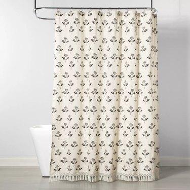neutral boho bathroom shower curtain idea with floral print and  tassel edge