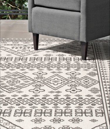 Ivory and black Moroccan style outdoor rug