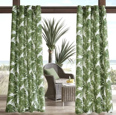 Palm leaf colored curtains in an outdoor beach setting