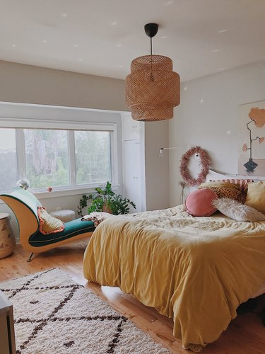 Designlovefest bedroom with Ikea pendant and yellow bedding
