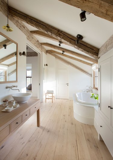 attic bathroom ideas with exposed beams and wood floor