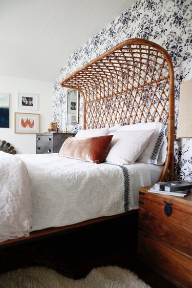 bohemian bedroom with floral wallpaper