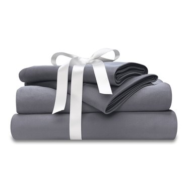 Gray sheets wrapped in white bow