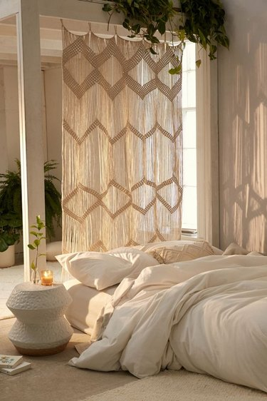 room divider idea for the living room with hanging macrame panel