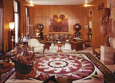 apartment with large patterned rug and wood walls