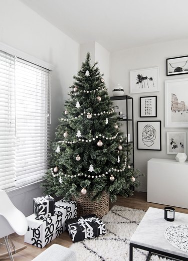 white living room with Scandinavian Christmas tree