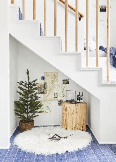 mini Scandinavian Christmas tree underneath the stairs