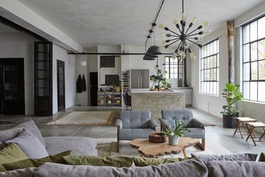 industrial style apartment living area with soothing color palette