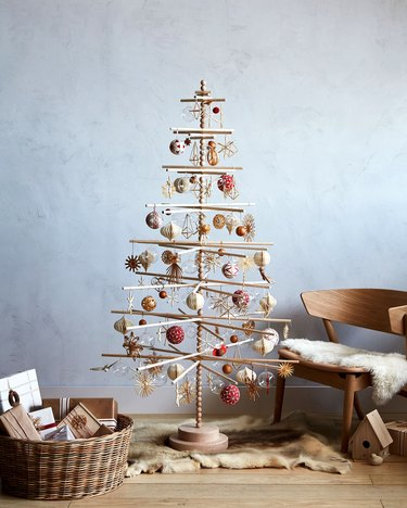 wooden dowel Scandinavian Christmas tree filled with ornaments