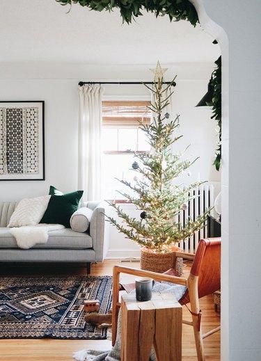 Scandinavian Christmas tree in the corner of a living room