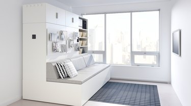 living space with couch and windows