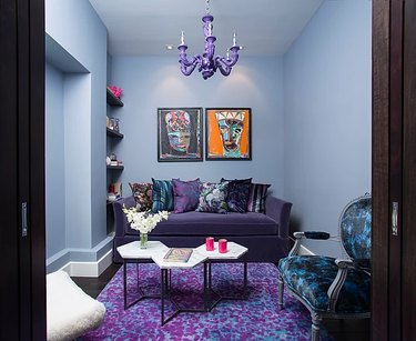 sitting room with purple rug and purple chandelier