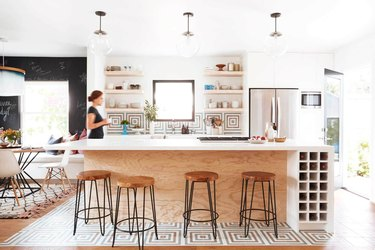geometric Mexican tile floor in kitchen with open shelving and wood cabinets