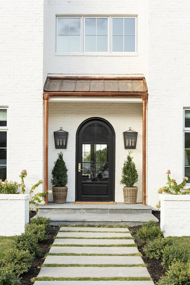 black exterior door idea with arched shape for white house