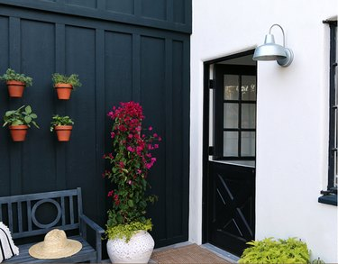 black exterior Dutch door, black and white walls