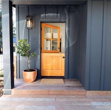 natural wood exterior Dutch door with gray walls