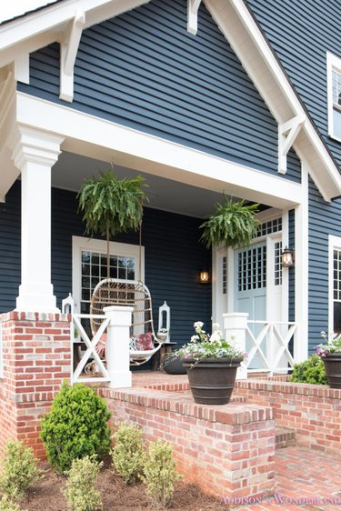 Navy and white farmhouse exterior colors on bohemian front porch