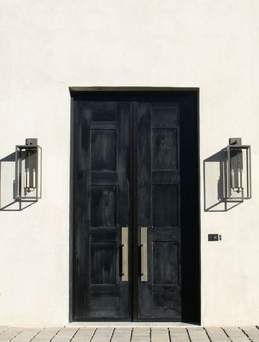 black exterior door idea for white house with industrial lighting