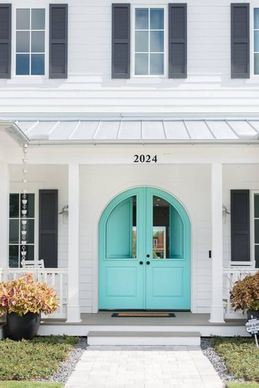 turquoise double exterior Dutch door, traditional white home