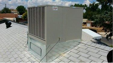 A rooftop evaporative cooler.