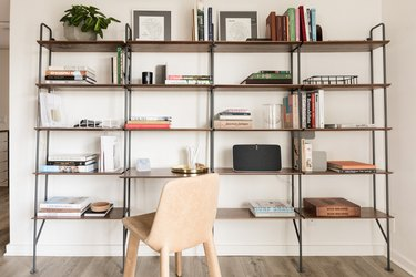 industrial pipe shelving wall unit with chair
