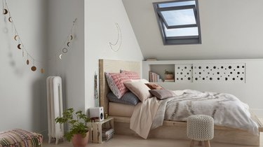 attic storage in bedroom with recessed shelf and moon phase